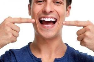 Man pointing at his healthy teeth