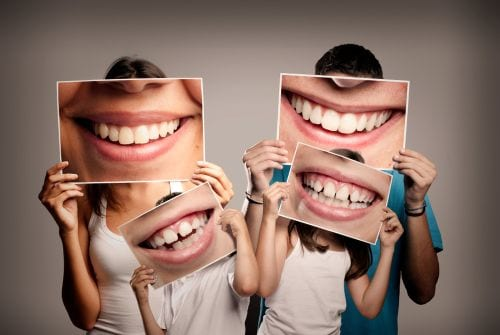 A family of four highlights their smiles after sticking to a strong dental hygiene routine.