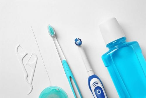 Flat lay composition with toothbrushes and oral hygiene products