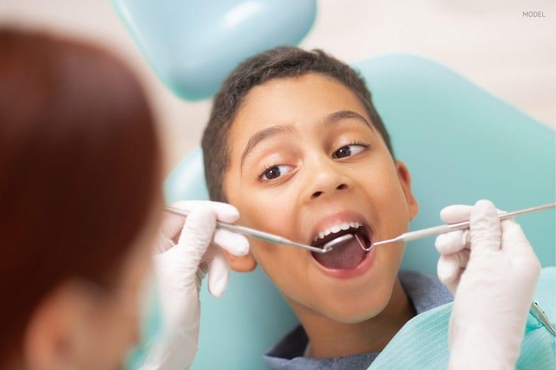 young boy at the dentist having a regular check up